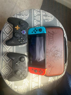 Nintendo Switch (used less than 5 times). Super smash bro, Mario Kart. Pro controller, wired Zelda controller. With Zelda case for Sale in Fort Lauderdale, FL