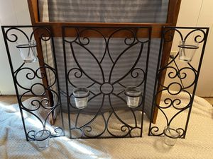 Black rod iron wall decor with candle holders for Sale in Alvarado, TX