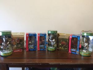 Tampa Bay Buccaneers collectable bobble head, big head and figurines for Sale in Tampa, FL