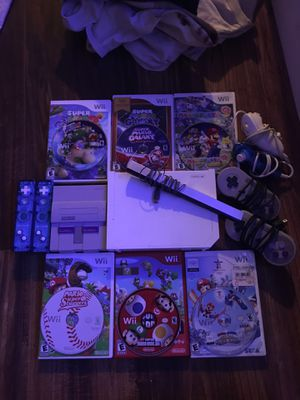 Super Nintendo entertainment system an wii with 6 games an 2 controllers for Sale in Alexandria, VA
