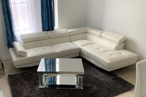 NEW WHITE GREY FAUX LEATHER SOFA SECTIONAL WITH ADJUSTABLE HEADREST for Sale in Boca Raton, FL