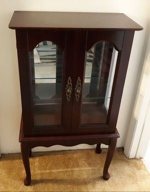 Cherry wood china cabinet/collectable cabinet for Sale in Clearwater, FL