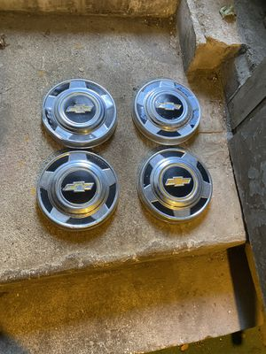4 hubcaps of Chevy vans and 3 different hubcaps of Cadillac for Sale in Lynbrook, NY