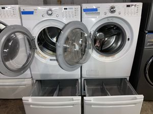 LG front load washer & electric dryer set with pedestals in excellent condition with 4 months warranty for Sale in Baltimore, MD