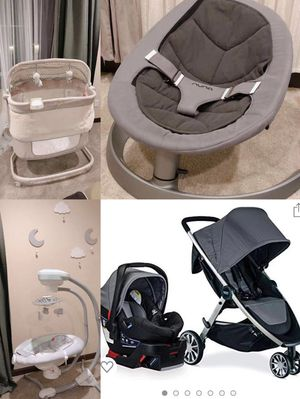 Baby stuff. sleeping baskets, swing, travel system for Sale in Bothell, WA