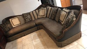 Corner couch in really good condition, the cushions has real feathers it comes with 12 pillows. The couch is made by Markor International Luxury Sofa for Sale in Glendale, AZ