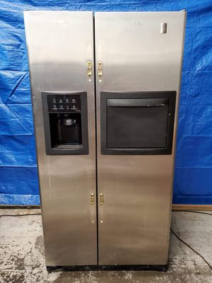 GE stainless steel fridge good working conditions for $149 *no handles but fridge and freezer working good for Sale in Denver, CO
