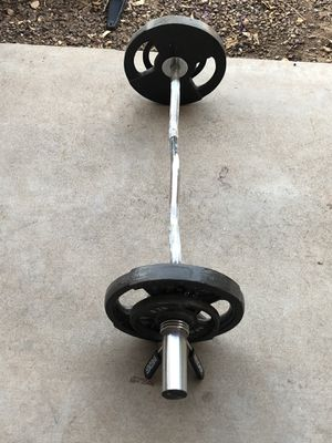 Apollo weights and Weider curling bar for Sale in Phoenix, AZ