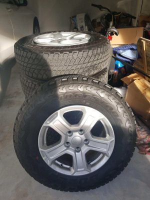 Jeep wheels, tires, and spare 245/45/17. Can be picked up in The Woodlands during the day or The Heights in the evening/on the weekend. for Sale in Houston, TX