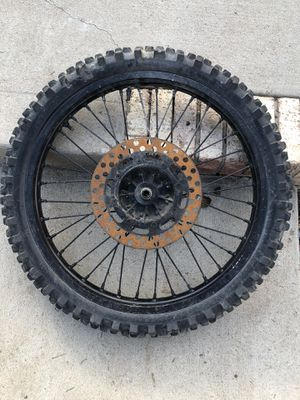 Honda dirt bike tire and rim for Sale in Denver, CO