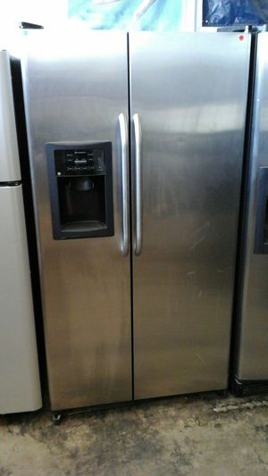 Refrigerator stainless GE side-by-side for Sale in Denver, CO