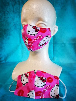 Kids Face mask (Hello Kitty Kisses): Hand made mask, reversible, reusable, washer and dryer safe. for Sale in Long Beach, CA