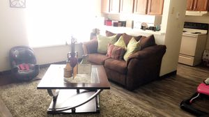 All brown sofa and love seat w/ 3 tables, 2 lamps, decorations included in pictures, green rug & tv stand included for Sale in Peoria, IL
