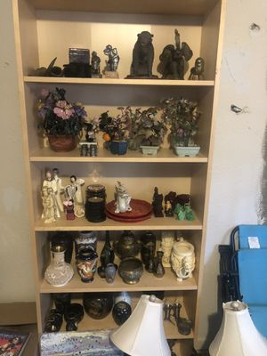 Shelf full of Asian, Native American, and clowns for Sale in Portland, OR