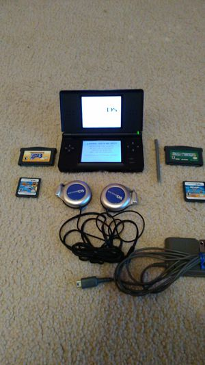 DS light blue headphones wall charger and 4 games for Sale in Kenmore, WA