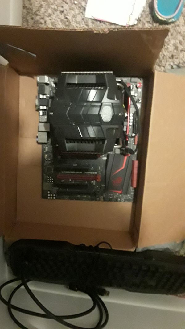 Cool master v8 GTS w/ crossblade ranger mother board and a keyboard. Gaming computer parts