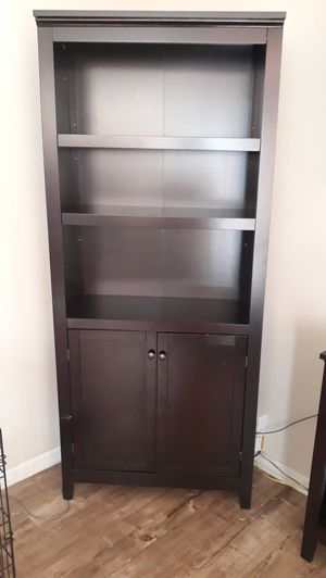 5 shelves bookcase with doors for Sale in Lynwood, CA