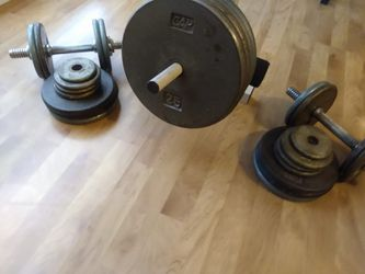 Exercise bench press with bar and 175 pounds of weights for Sale in The Colony,  TX