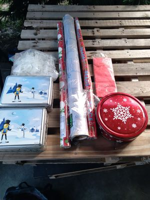 CHRISTMAS WRAPPING PAPER 3 TIN CANS ,TISSUE PAPER AND PLASTIC HOOKS TO.HANG LIGHT ON YOUR HOUSE for Sale in Tampa, FL