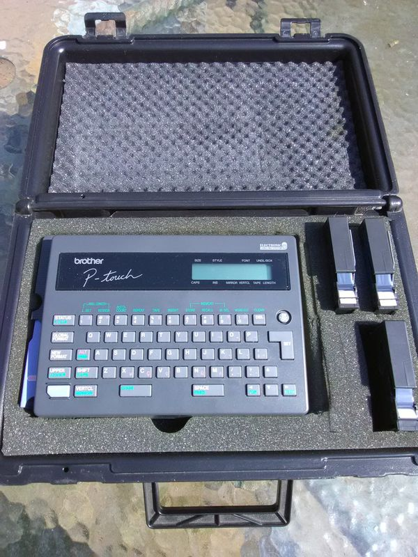 Brother P-Touch Label maker with tape and Carrying case