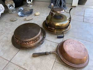 Vintage Copper Cooking set includes 1 Pan with wooden handle, 1 round copper pan with 2 black handles and 1 large copper pot with stand on 3 legs for Sale in Boiling Springs, SC