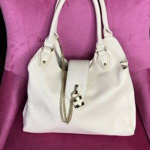 NWT Cream Colored Hobo Bag with Gold Lock and Chain for Sale in New Port Richey, FL
