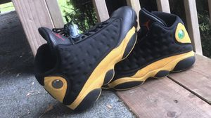 Jordan 13s black and yellow size 10 for Sale in Seattle, WA