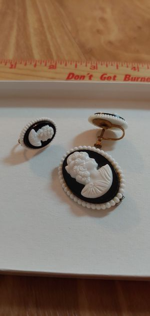 Cameo brooch and clip on earrings. Black and white for Sale in Austin, TX