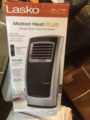 Lasko ceramic heater Remote control oscillating look at pics new for Sale in Lakewood, WA