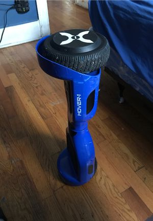 Bluetooth hoverboard Color is dark blue for Sale in Detroit, MI