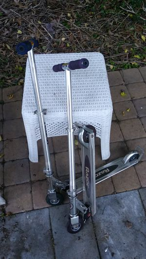 2 Razor scooters 1 purple & 1 blue and chrome for Sale in Palmyra, NJ