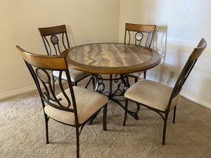 Faux stone center table 4 chairs like new for Sale in Las Vegas, NV