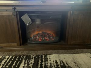 Tv stand up to 80 inch with sliding doors and fire place for Sale in Rock Island, IL