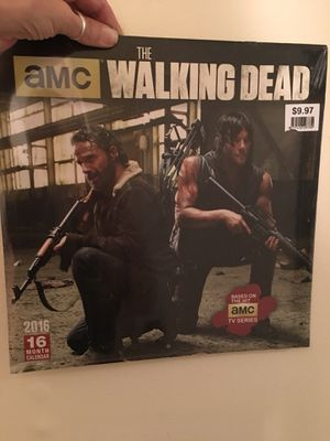 Walking dead book 1 and 2 and a calendar for Sale in Nashville, TN