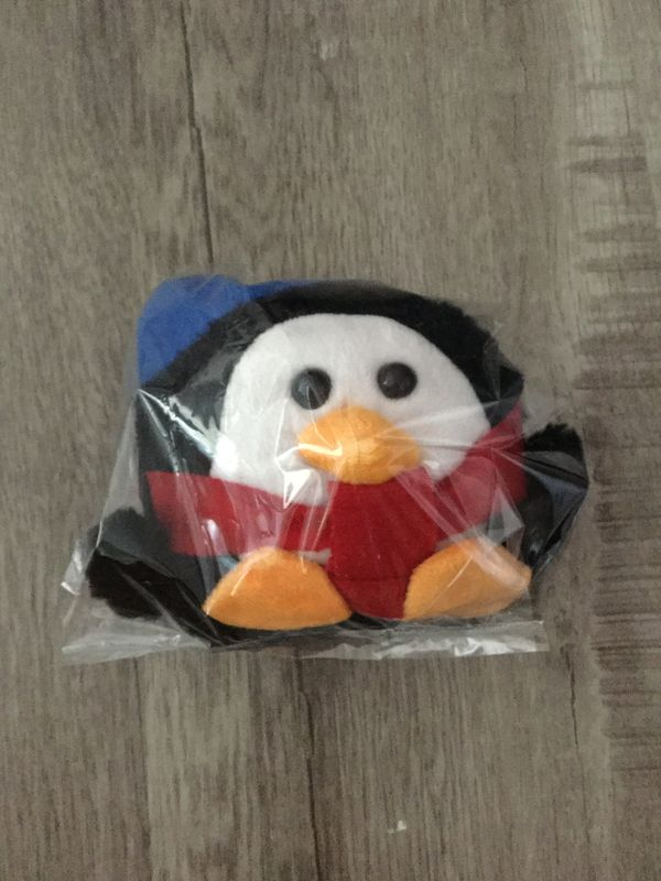Small plushie penguin with scarf