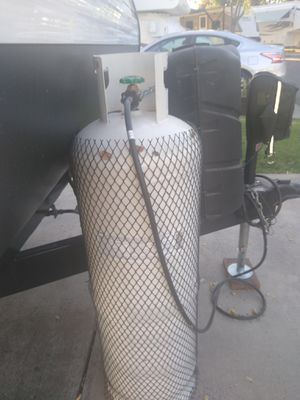 Full of propane tank and it's brand new nothing's wrong with it that comes with hose and adapters for Sale in Manteca, CA