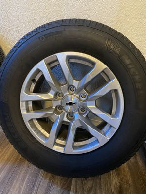 I have a set of 2019 265/65/18 inch Chevy Silverado 6 lug tires and wheels with new Michelin tires with no dents or scratches on the rims that will f for Sale in Pittsburg, CA