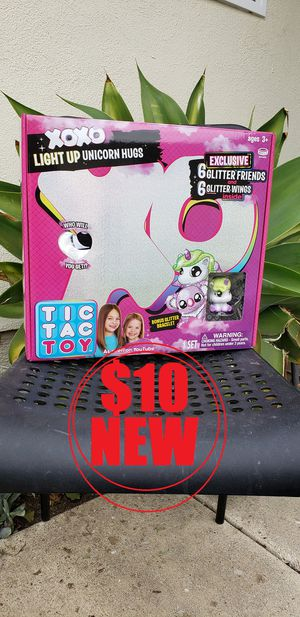 Tic Tac Toy LOL Surprise Light Up Unicorn stuffed animal toy. BRAND NEW INCLUDES: 1 XOXO Light Up Unicorn plushie, 6 Glitter Friends, 6 Gitter Wings for Sale in Ventura, CA