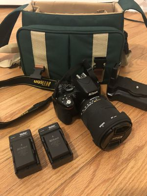 Nikon D5100 with Canon Carrying case , 2 batteries with chargers, extended battery holder , and Sigma Dc 18-200mm Lens for Sale in Chicago, IL