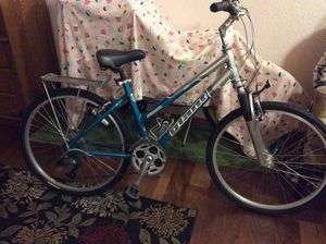 Woman's beautiful teal and silver Giant Sedona bike. A rack over the back tire for carrying items.....water bottle rack fits most containers. Tires for Sale in Lake Stevens, WA