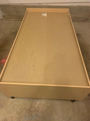 Twin wooden bed frame with roller wheels for Sale in Herndon, VA