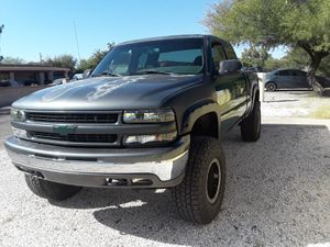 2000 Chevy Silverado extended cab 4 x 4 211000 MI rebuild motor newer transmission runs very strong starts right up salvage title needs a little work for Sale in Tucson, AZ