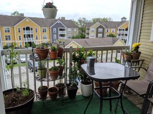 Patio table, fake grass carpet, pot stand for Sale in Columbus, OH
