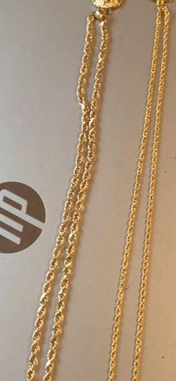 (AUTHENTIC & CAN TEST) 10karat hollow gold rope chain and charm. 22karat gold rope chain and charm for Sale in Albany,  GA