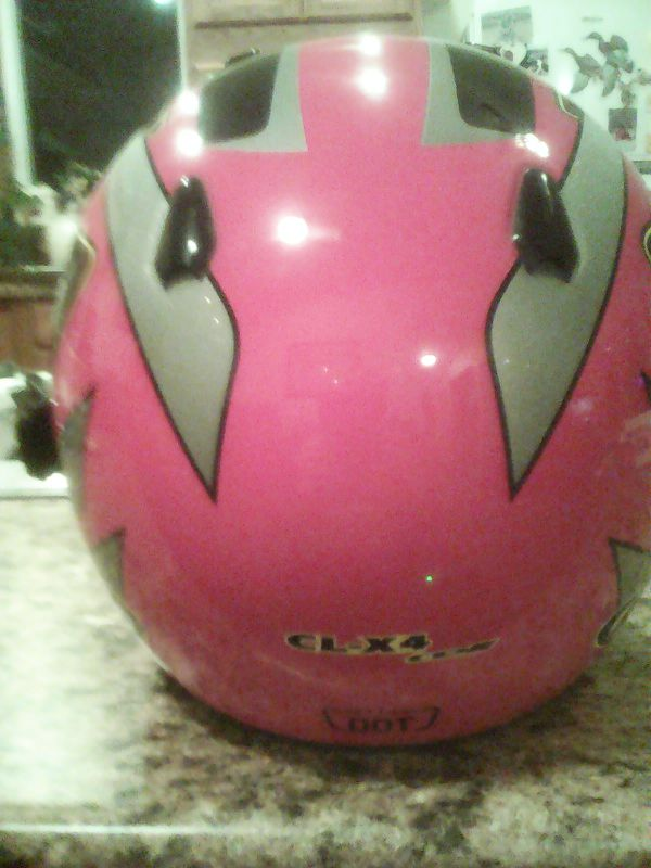 Helmet is HJC and is DOT approved the helmet is red not pink sorry lol is size large in very good condition