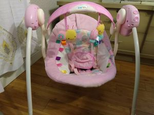 Baby girls swing, with batteries, variable speed, folds flat for Sale in Tampa, FL