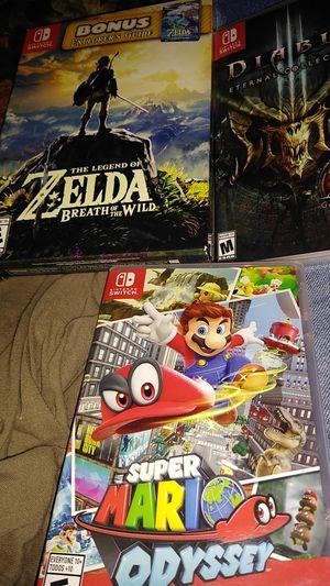 3 Nintendo switch games. Mario odyssey-Diablo eternal collection-The legend of Zelda breath of the wild bonus explorers guide for Sale in Salt Lake City, UT