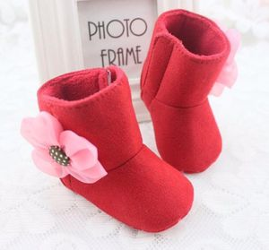 New red boots for a baby girl size 0-6 months with a flower on the side for Sale in Pinellas Park, FL