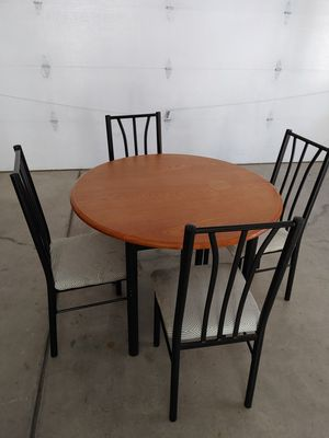 Nice round wood table 4 metal chairs !!! for Sale in Denver, CO