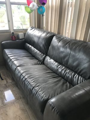 Grey leather couch for sell for Sale in Boynton Beach, FL